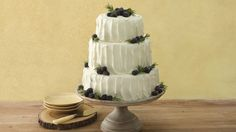 This beautiful rustic wedding cake is perfect for the summertime, when berries are in season and the blackberry preserves are extra sweet.