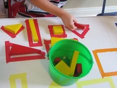Explore shapes using blocks and taped outlines like Teach Preschool