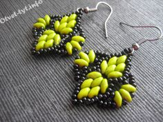 earrings with beads SuperDuo;  this site has a 6 page index of master classes with photo tuts.  Worth spending some time.