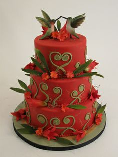 And a stunning red wedding cake with Hummingbirds topper from Charm City Cakes in Baltimore, Maryland.