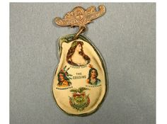 Advertising pin for Garrett & Company made specially for the Jamestown Exposition of 1907 in Norfolk, Virginia. The front features color images of Pocahontas, Virginia Dare and Minnehaha.