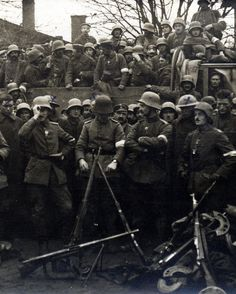 "WW1: German stormtroopers pose en masse for the camera. Several persons in the photo are marked with an ""X;"" two of them wear British Tommy ""tin hat"" helmets. It is possible that these ""marked"" mean are POWs taken during a raid. This level of temporary ""fraternization"" was common in WW1 for the purposes of commemorating ""victories."" Undated."