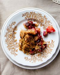Cranberry Apple Raisin Crisp Recipe on Food & Wine - I found a bag of frozen cranberries in the freezer, so I decided to make this.  I substituted almond meal for the flour and cinnamon for the cloves and it was great!