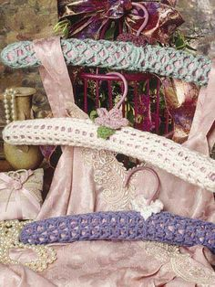 """Padded Hangers- Give a touch of luxury to your friends and family with these padded hangers. They fit a standard 15 1/2"""" padded hanger and use only a small amount of WW yarn to stitch. Skill Level: Easy  Designed by Jan Hatfield  free pdf from freepatterns.com"""