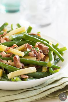 Jazz up your side dish with this Green Bean Recipe with Frizzled Prosciutto and Gouda. It is quick and delicious and a little different from the norm.: