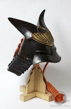 Kawari kabuto.  It is made mixing urushi laquer to papier-mache in order to obtain a very light thus resistant material that can be used to decorate the heavy iron bowl.