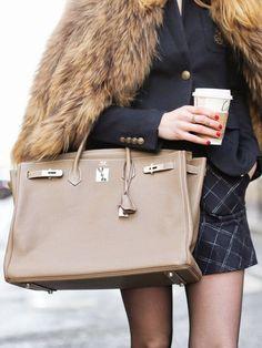 A blazer is worn with a fur stole, Birkin bag, and plaid skirt