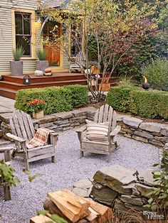 When designing your outdoor space, use a variety of materials to add texture and visual interest. Here, gravel, stacked stones, green shrubs, and a wooden deck work together to create a visually pleasing layered look./
