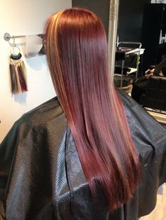 My red hair with peekaboo caramel highlights done by Rachael at Rock Paper Scissors