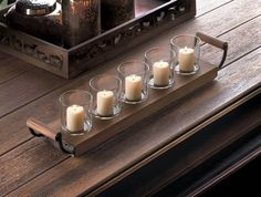 Simple in design, this elementary candle holder is simply stunning when filled with five of your favorite votive candles! Made from wood and glass with metal accents, it makes a great style statement