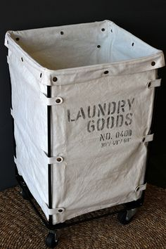 Laundry shoot basket, prefered over a cabinet that you have to pull clothes out of, they free fall into this and even better that it has wheels