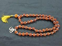 Five Mukhi Rudraksha Kavach Mala of 54 + 1 Guru Bead Om Pendant with Small Pearl Spacer Yoga Japa Mala Mogul Interior, http://www.amazon.com/dp/B00856ZR8Q/ref=cm_sw_r_pi_dp_8fEXpb17CT5RK