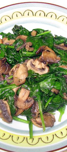 Sauteed Spinach and Mushroom: 1 T light olive oil, 4 small cloves/sections fresh garlic, 1 (8-oz.) pkg fresh mushrooms, 2 t butter, 1/4 c red, dry wine, 1 t dried thyme, 1 bag fresh spinach (about 10-oz.).