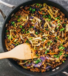 This is a super fast and easy stir fry dinner with ground beef, cabbage, carrots, and scallions. Only 20 minutes needed to make this simple meal.