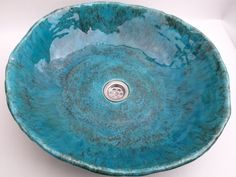 Overtop, unusual and durable sink in turquoise! Handmade in our workshop. Resistant to detergents and high temperature. Made of clay and enamel (ceramic). We specialise in unordinary personalised...
