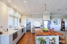 The farmhouse kitchen is an integral connection for family living, dining and the sheltered outdoor alfresco setting.