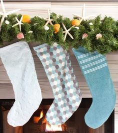 DIY Christmas Stockings made from beach towels: http://www.completely-coastal.com/2013/11/DIY-coastal-holiday-decor-HGTV.html