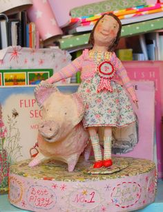 The little girl is called Emily, and her piggy.