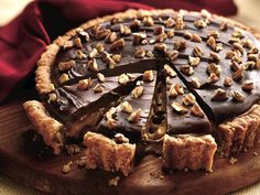 Chocolate Turtle Tart - Prize-Winning Recipe _ Show-stopper desserts can be delicious as well as super simple when you start with a time-saving cookie mix! Yummy Treats, Sweet Treats, Yummy Food, Tart Recipes, Cooking Recipes, Yummy Recipes, Cooking Tips, Dessert Crepes, Cupcake Cakes