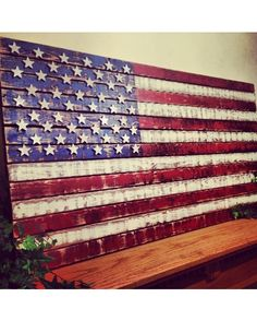"This wooden American flag measures 37"" wide by 18"" tall.  This makes a perfect gift for any occasion for any person young or old! Every flag is distressed by hand to make each one unique."