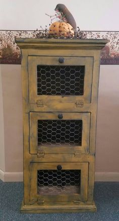 Made to order 3 door potato, onion, vegetable bin. We can paint color of your choice. This one pictured is a rustic mustard. Measures 40 tall, 19 wide, 13 1/4 deep.