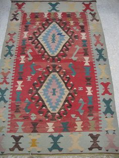 Vintage and Nomadic Turkish Kilim Rug from Touros Mountain in Turkey  Cotton on Wool Combination . Hand Woven Kilim Rug  Size is. 43x 67 inches / 109 x 170 cm  Appx. 40 - 50 years old Vintage Piece  Dyed by Nomadic Turkish Villagers Design is Totally Bohemian and Traditional Turkish Design.  Ready Piece ..it is been washed .  Shipment will be Via by fedex or UPS after your purchase you will have it max 7 business days If you are not satisfied with your rug, You return 7 days time from…