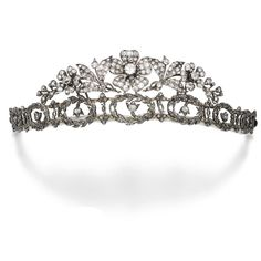 Diamond tiara, late 19th century composite. Of floral and garland motif, set with cushion-shaped and rose diamonds, the three central flowers can be detached and worn as brooches. Provenance: Hilda Constance Helen Blackburn, granddaughter of Claude Bowes-Lyon, 13th Earl of Strathmore and Kinghorne, thence by decent.