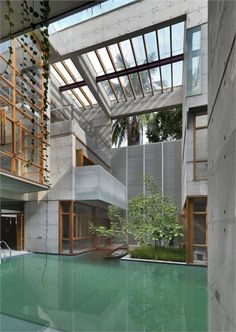 A little too modern for my liking, but it's a cool idea! Inside/ outside atrium area with pool