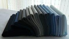 A fat quarter bundle of Kona cotton solids by Robert Kaufman in the Blue-Black color spectrum.  Ash, Black, Bluebell, Charcoal, Coal, Delft, Denim, Indigo, Iron, Medium Grey, Navy, Pepper, Slate, Sky, Steel and Windsor.