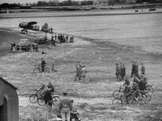 8Th Air Force Bomber Command US 8th Bomber Command, B-17 Flying Fortress ground crew riding English bicycles as they return to hangar after serving planes before take-off; each has a bike which they routinely use to get to & fr. their planes, at airdrome in southern England. Location:	United Kingdom	September 1942 byMargaret Bourke-White