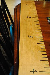 Make your own wall growth chart with a board from Home Depot. Tutorial can be found: http://naptimedecorator.blogspot.com/2011/10/ruler-growth-chart.html