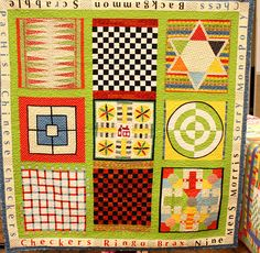 This quilt was amazing. All the game boards are pieced with fabric.