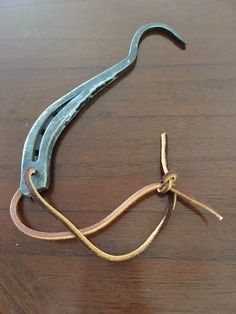 Surprise the horse-lover in your life with a hoof pick hand-forged from a repurposed horseshoe!  Great for everyday use or as a cool decoration.  Hang it up by the leather strap. $12 + $6.75 Priority Shipping