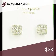 NWT Mini Silver Opal Glitter Square Earring Studs New with Tags Mini Silver Opal Glitter Square Earring Studs by Kate Spade.  Measures approximately .25 inches. Stainless Steel post. Beautiful kate spade Jewelry Earrings