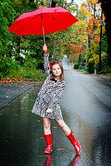 adorable shoot in the rain with and umbrella