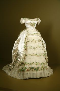 1869 wedding gown of Elisabeth of Wied, Queen Consort of Romania. The dress is made of silk satin, silk tulle with cotton and paper faux flowers.
