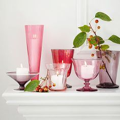 Mismatch Glass Pieces for Your Mantel - pair a few red-hue glasses, votives, vases, and champagne flutes together and fill with mini white candles. Tuck a few real or faux berries around the containers for a lovely interior accent.