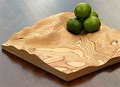 Custom manufacture, geography, and modern design. The European company Fluid Forms lets you specify any location on Google Maps, and then they custom mill a laminated wood bowl matching the topography of your choice.