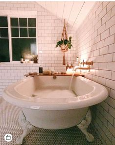 very pretty free-standing tub with faucet straight from the wall.