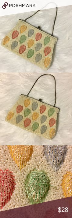 Vintage beaded purse, cream with colorful leaves Vintage 50's or 60's beaded purse. Cream colored with blue, green, red, & yellow leaf design. Can be used as a clutch or with strap. One leaf has lost some beads  & one bead is missing from the bottom, but still in really beautiful condition. Some discoloration from makeup inside and normal wear to silver top part of purse, all noted in pics. Priced accordingly for normal vintage wear.  Measures: 7.5in long 5.25in from top of closure to bottom…