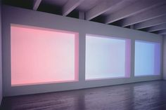 Amba (1983) by James Turrell -- A Turrell Space Division (also called an 'Aperture' work) consists of a large, horizontal aperture which appears to be a flat painting or an LED screen but is a light-emitting opening to a seemingly infinite, light filled room beyond.