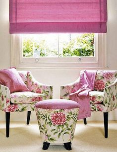 This feels like spring with pink soft roman shades with floral print upholstery.