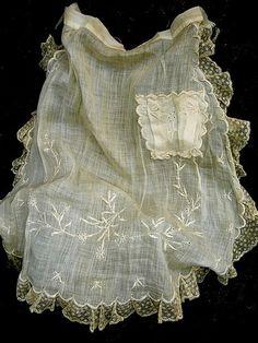 Fragile linen and lace apron