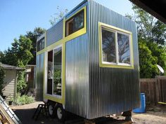 A tiny big home.  Jenine Alexander and Amy Hutto, two craftswomen who decided to challenge the popularity of McMansion and the car culture that currently defines the U.S. They set out to build passive solar and zero energy homes from recycled and salvaged materials. What they created was a tiny mobile home build on the bed of a used trailer.