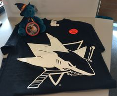 Halloween merchandise, including a glow in the dark Sharks tshirt, available at the Sharks Store.