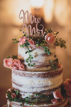 "The perfect gold ""Mr. & Mrs."" cake topper for your elegant, blush pink, naked, spring wedding cake! Photo taken at THE SPRINGS Event Venue. Follow this pin to our website for more information, or to book your free tour! SPRINGS location: Sycamore Hall in Angleton, TX Photographer: Kelly Costello Photography #weddingcake #weddingcaketopper #caketopper #nakedweddingcake #blushpinkwedding #blushpinkweddingcake #weddingcakeideas #bohoweddingcake"