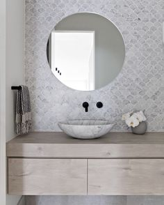 Bathroom with fishscale tiles, Oak vanity, Carrara marble bowl, round mirror and black wall taps – Marble Bathroom Dreams Marble Bathroom Floor, Mosaic Bathroom, Small Bathroom, Mosaic Tiles, Bathroom Black, Bathroom Ideas, Modern Bathroom, Master Bathrooms, Carrara Marble Bathroom