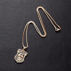 This charming pug face silhouette necklace is handcrafted and 18k rose gold plated. The pendant is 27x20mm with a chain of45cm (18in) long.FREE worldwide ship