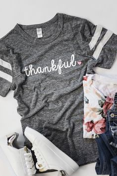 Thankful for the love of little ones! Heathered Grey Tee with Unisex Fit See Courtney's sizing HERE, she is wearing size Small 50% Polyester, 38% Cotton, 12% Rayon