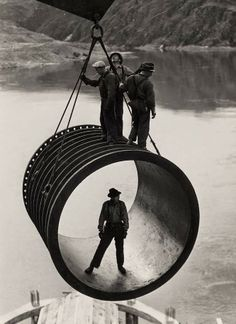 Today's picture shows construction workers moving a large pipe. The picture is from the Grand Coulee Dam project in Washington State. Around 1940.